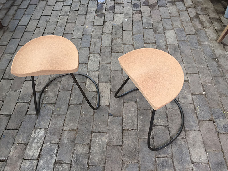 A pair of sway stools designed and created by Patrick Bateman of HB Studios. The seats are formed from cork and the base is bent cast iron.