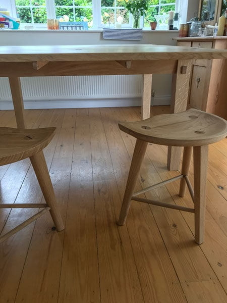 A pair of a bespoke made to order handmade stools to compliment the extending oak dining table.
