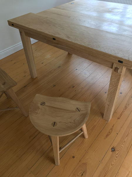 Top detail of one of a pair of a bespoke made to order handmade stools to compliment the extending oak dining table.