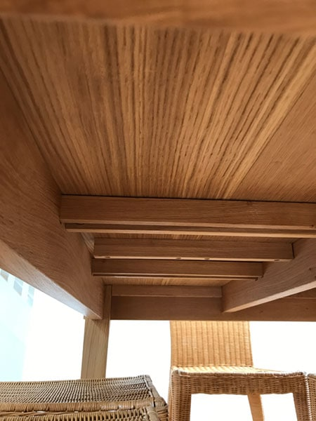 Underside detail of a bespoke made to order handmade extending oak table showing underneath support stretchers.