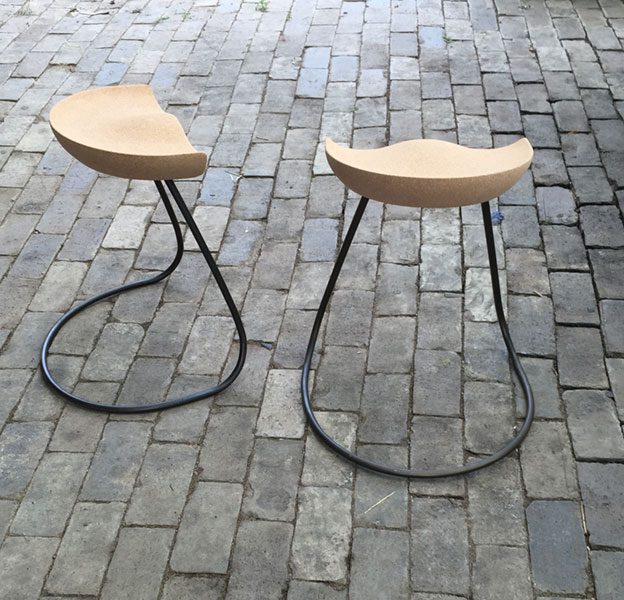 A pair of Sway stool made from steel and cork designed and made by HB Studios