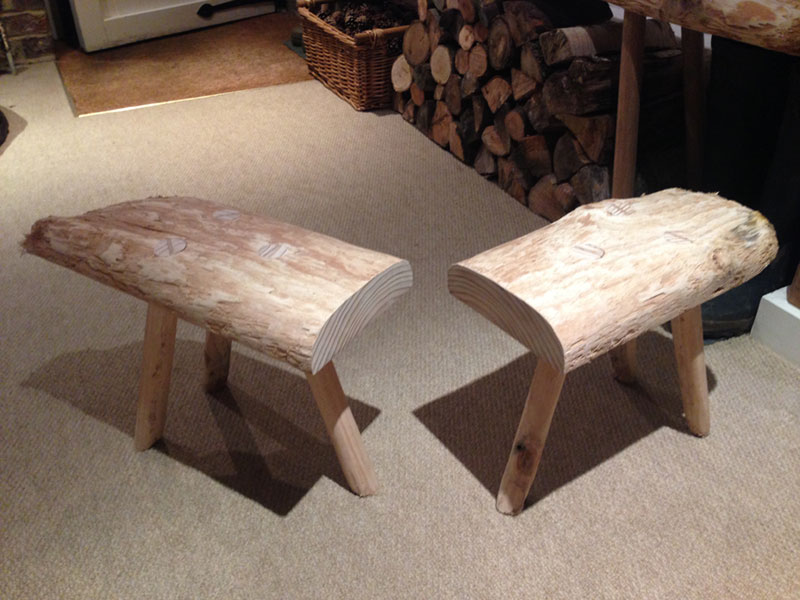 The finished articles - two rustic handmade wooden milking stools designed and produced by HB Studios in Somerset