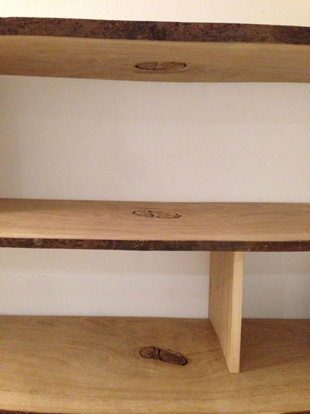 curvy handmade bespoke wooden shelving with natural bark edge